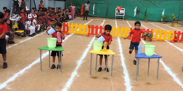Bottle Filling Competition For Kids In Kindergarden Sports Day.