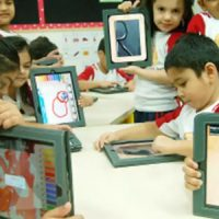 Preschooled Kids Holding Tablet In Their Hand - Replicates Technology Concept In Kindergarden.
