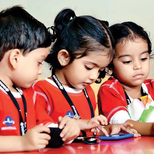3 Kindergarden school students using android mobile