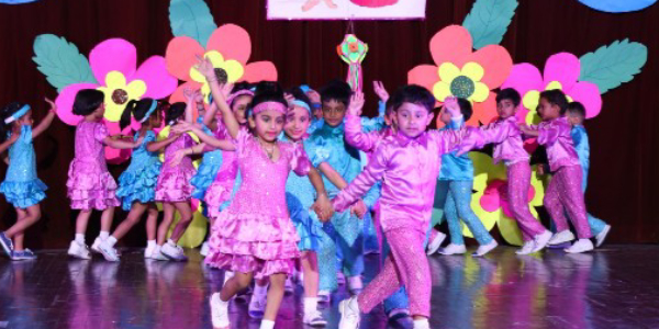 Cute Little Kids Performing On The Stage During Their Annual Day Celebrations.