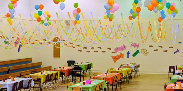 Kindergarden Classroom Decoration With Color Papers And Balloons.