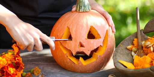 Pumpkin Carving For Halloween Party In Kindergarden